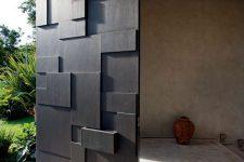 27 sculptural black metal front door