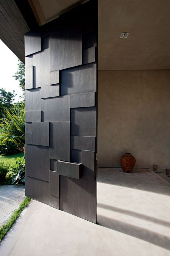 sculptural black metal front door