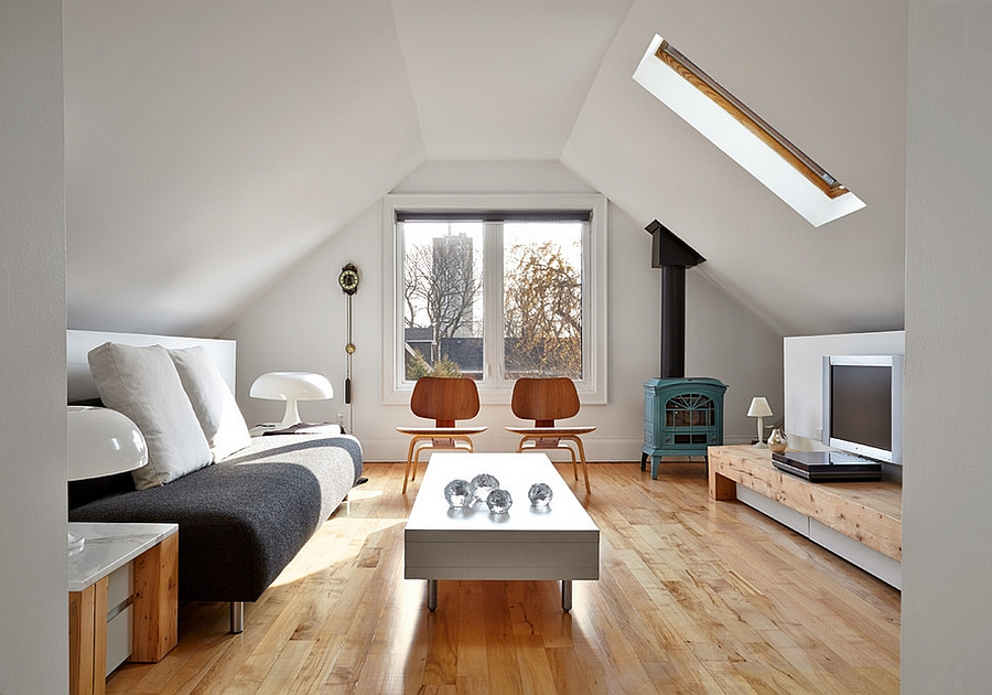 simple modern attic living room with an antique fireplace