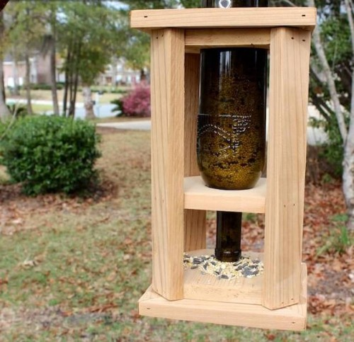 DIY wine bottle and wood bird feeder (via www.shelterness.com)