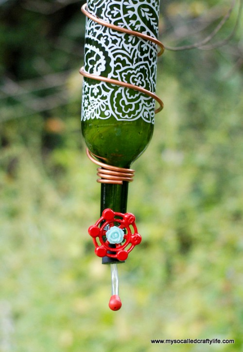 DIY hummingbird feeder from a wine bottle (via www.shelterness.com)