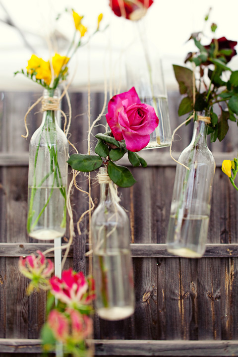 DIY hanging floral arrrangement using wine bottles (via www.shelterness.com)