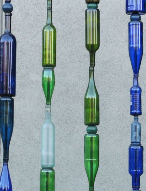 DIY outdoor fence from wine bottles (via www.shelterness.com)