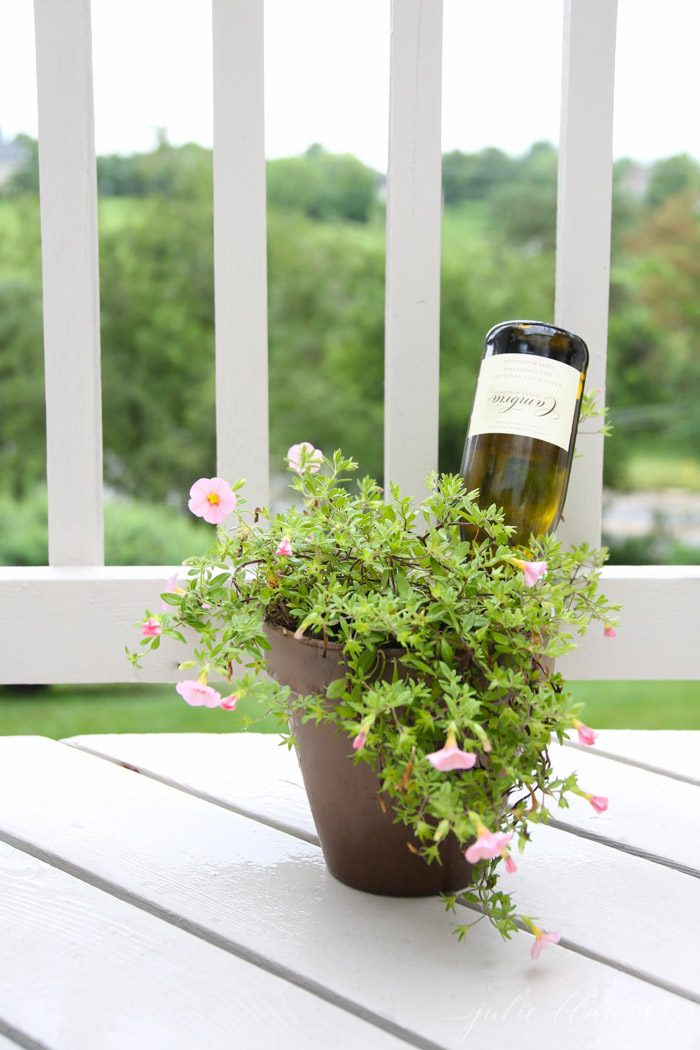 DIY plant waterer from a wine bottle (via julieblanner.com)