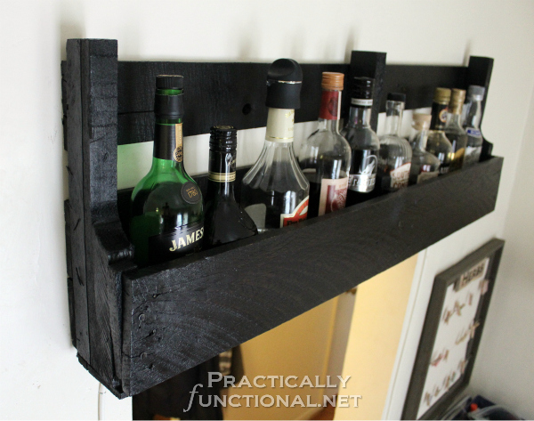 DIY dark stained rustic wine rack (via www.practicallyfunctional.com)