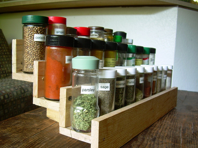 DIY spice rack of stripped pallet wood (via www.shelterness.com)