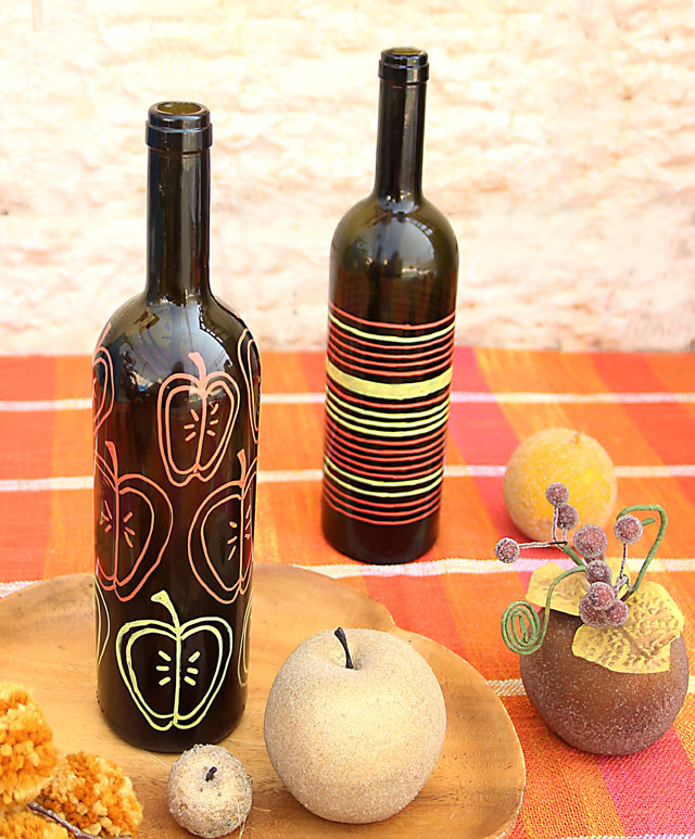 DIY apple painted wine bottle vases