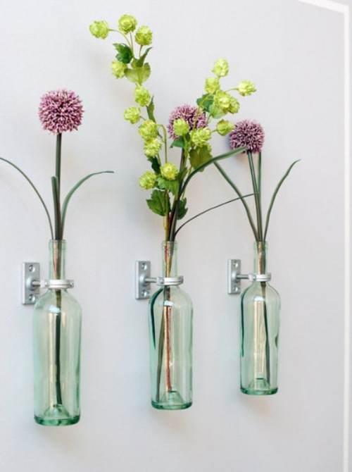 DIY wine bottle wall vases (via www.shelterness.com)