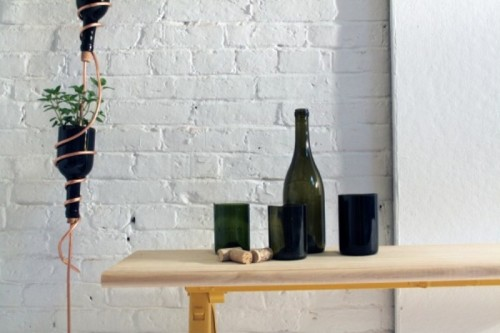 DIY wine bottle herb garden (via www.shelterness.com)