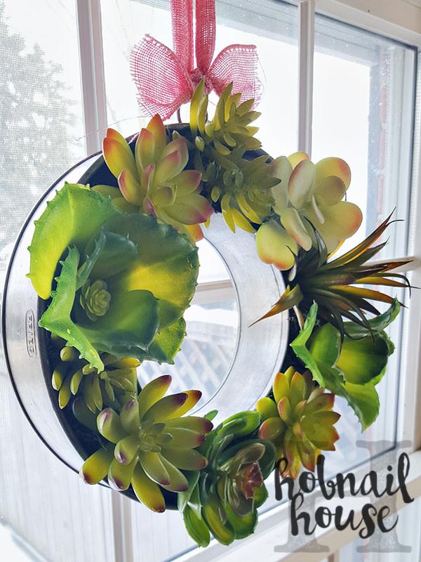 DIY faux succulent ring mold wreath (via hobnailhouse.com)