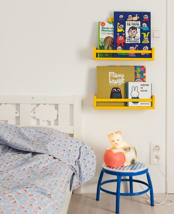DIY bold yellow kids' bookshelves from Bekvam racks (via petitandsmall.com)