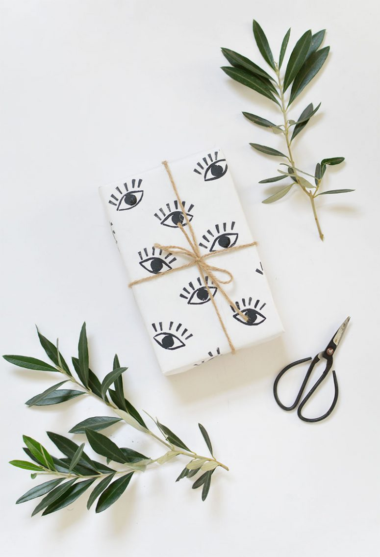 DIY eye stamped wrapping paper (via burkatron)