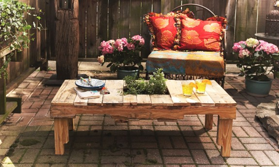 DIY outdoor pallet table with a garden in it