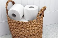 02 a woven basket holds an ample supply of toilet paper