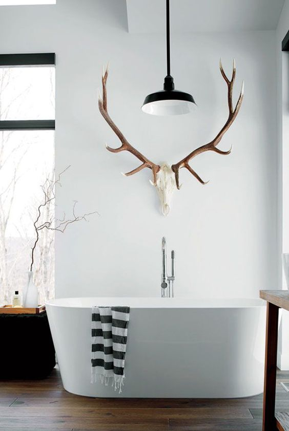 Popular antler towel holder gives this modern bathroom a cabin feel