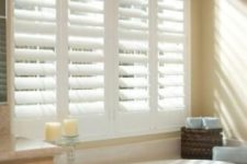 02 classic white shutters provide perfect privacy not depriving you of the views