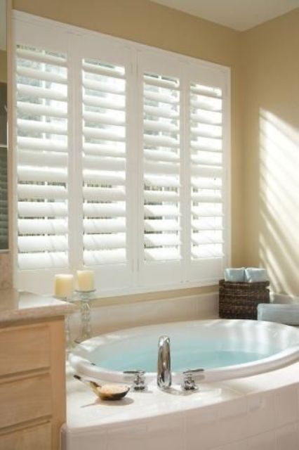 classic white shutters provide perfect privacy not depriving you of the views - Bathroom Window Treatments