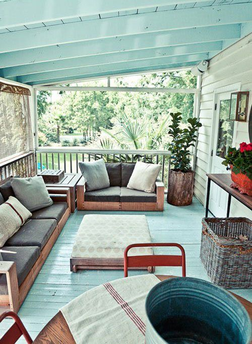 screneed porch with wooden furniture