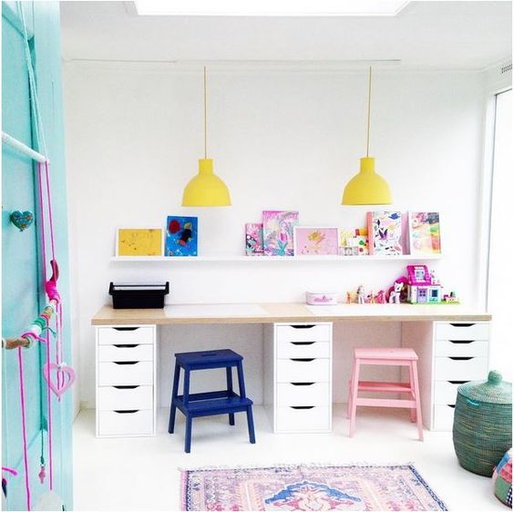 shared kids study nook with bold stools and lamps