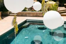 02 white balloons over the pool for an airy feel