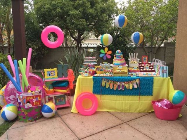 bold dessert table decorated with beach balls and life savers