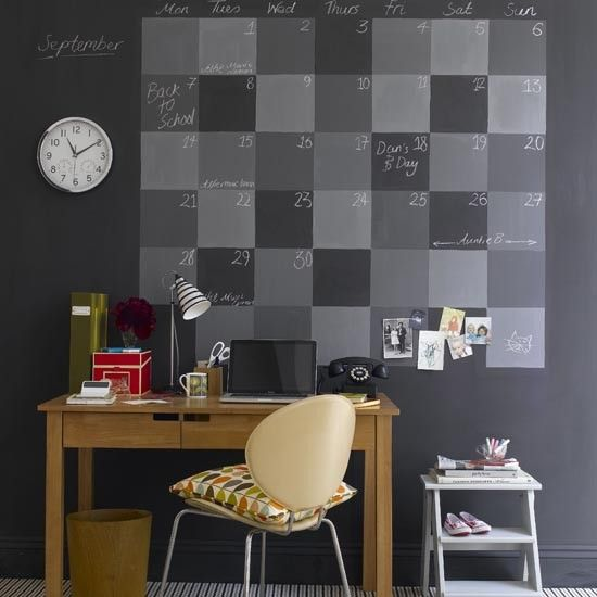 boy's study space with a chalkboard calendar and a clock