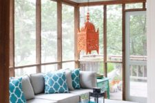 03 screened porch with lively colorful decor