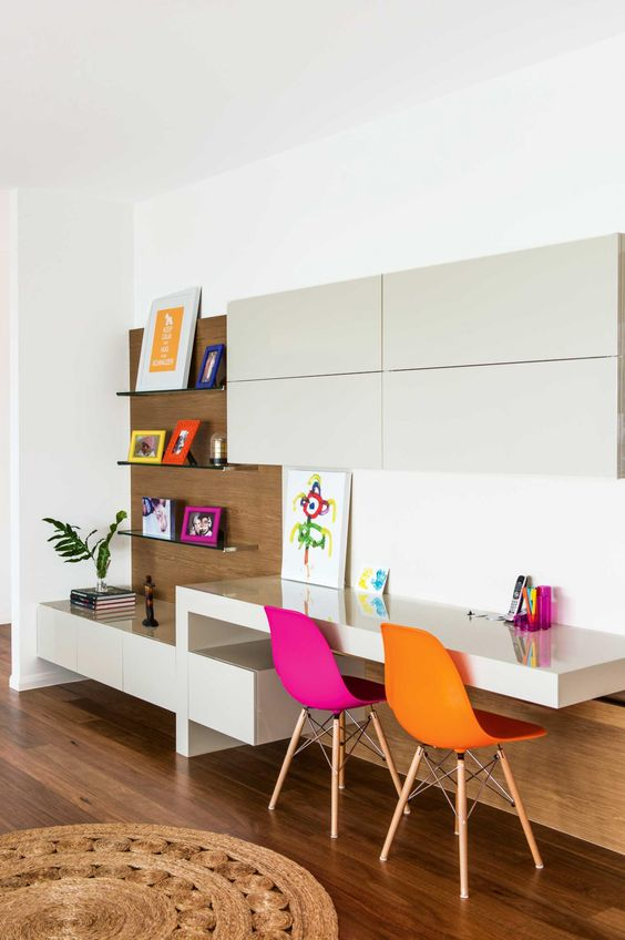 bold minimalist study space with colorful chairs