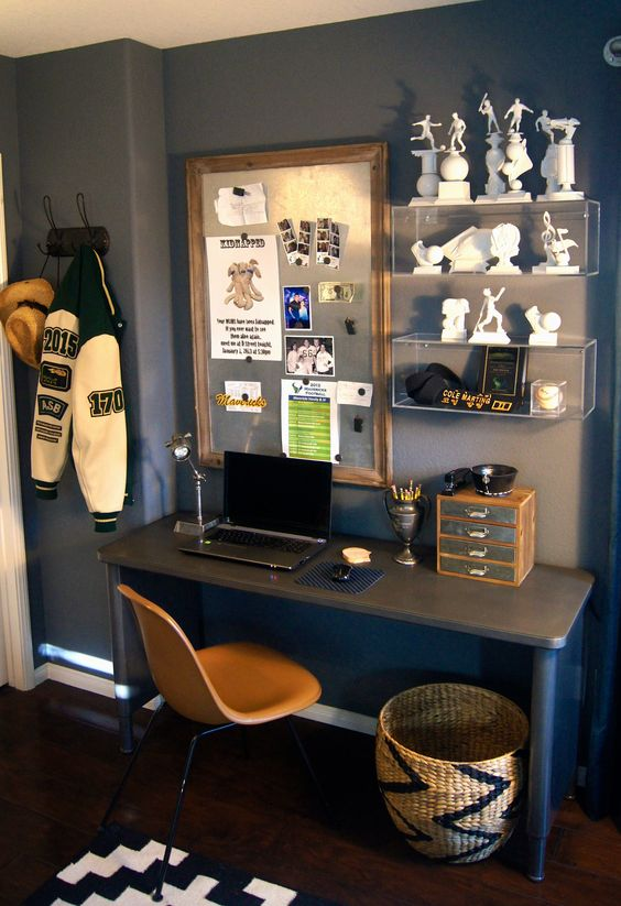 04 boy's study space with a magnet board and sport trophies on the shelves