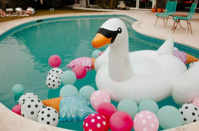colorful and fun balloons and floats for a bachelorette pool party