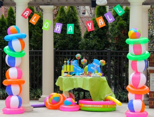 drink table with bold decor and beach ball pillars on the sides
