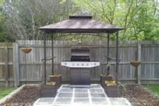 04 metal grill gazebo anchored by container gardens