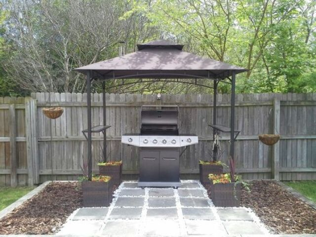 metal grill gazebo anchored by container gardens