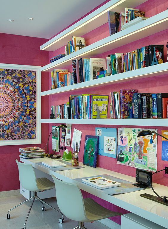 pink walls and a mosaic wall art make this nook more eye-catchy
