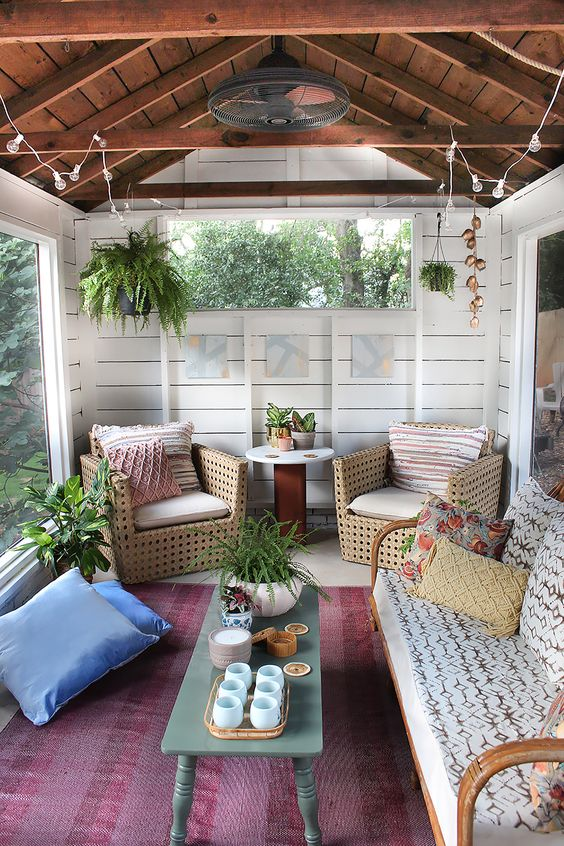 screened porch from an old shed decorated in a relaxed style