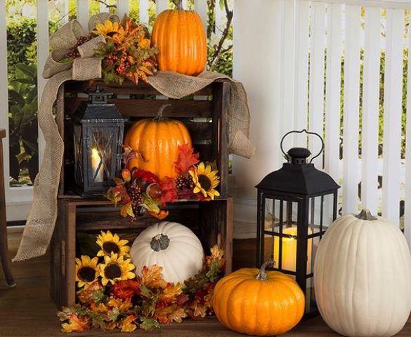 crate pumpkin and faux leaves display and a lantern