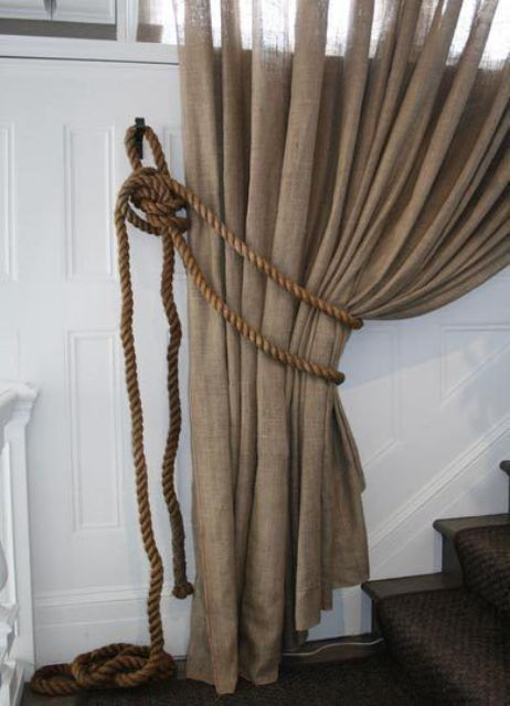 curtains made out of burlap paired with jute cords