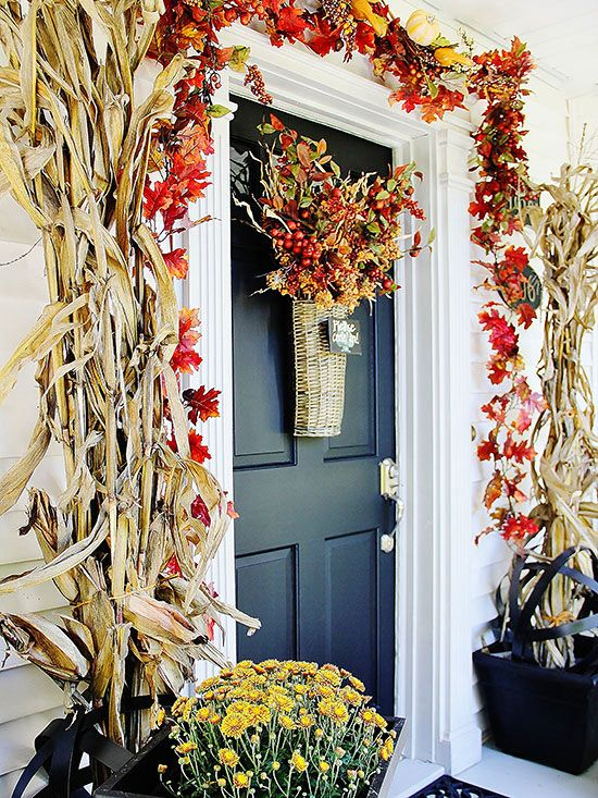 flanking your door with towering cornstalks is a bold seasonal statement