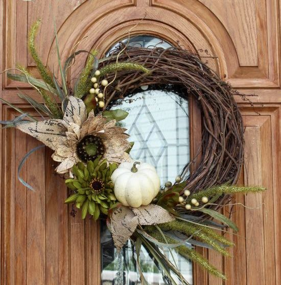 grapenvine wreath with faux greenery and a pumpkin