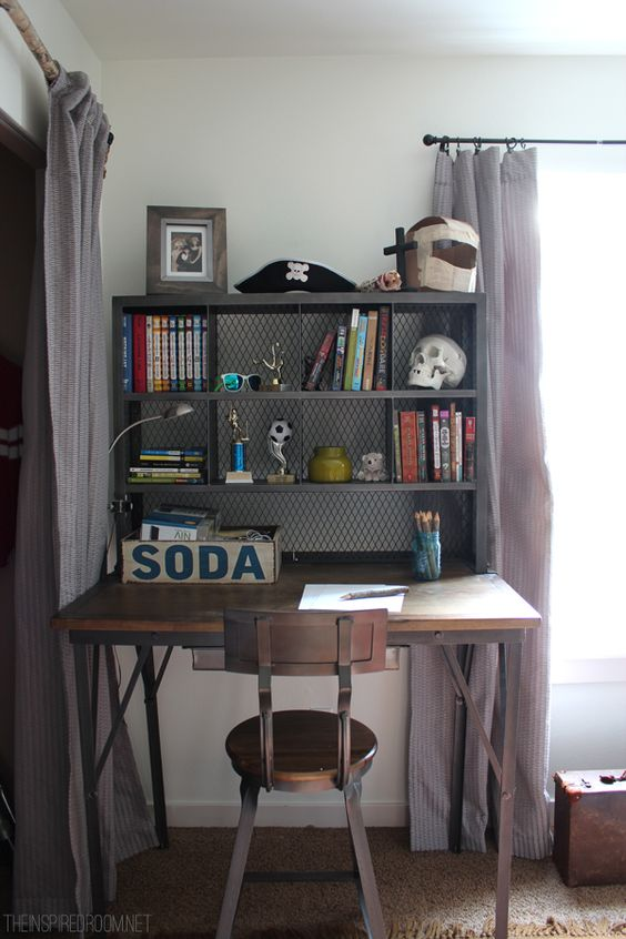 ndustrial study nook with a desk and a shelving unit placed on it