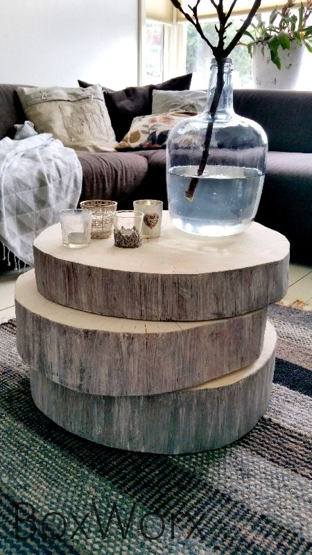 oversized wood slices stacked as a coffee table