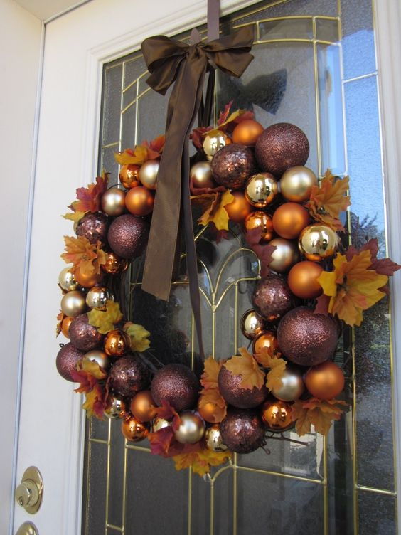 fall wreath made of Christmas ornaments and leaves