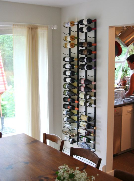 metal wine shelf with bottles to hang in the dining area