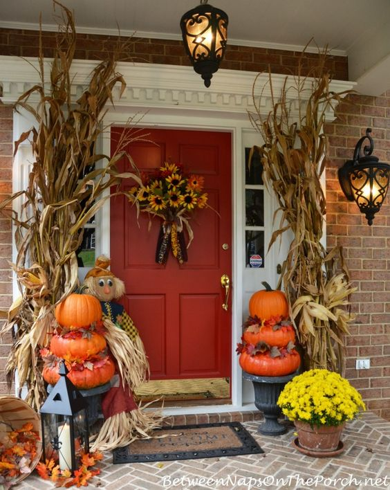 pumpkin topiaries, corn husks and a scarecrow