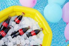 07 drinks in ice placed into a pool float