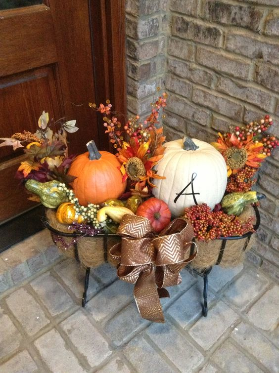 fall porch stand with hay, pumpkins and silk flowers