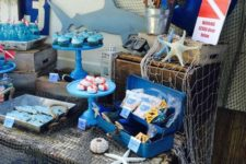 07 shark-themed dessert table with nets and anchors