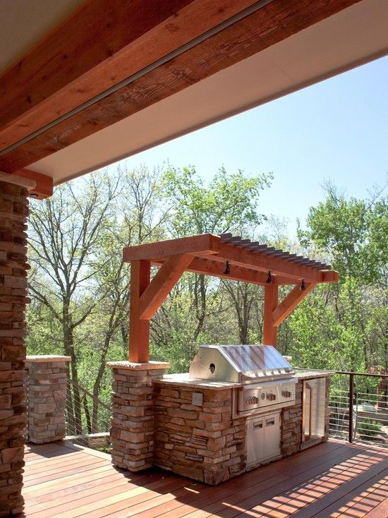 small pergola over the grill for maximum ventilation and to take less space