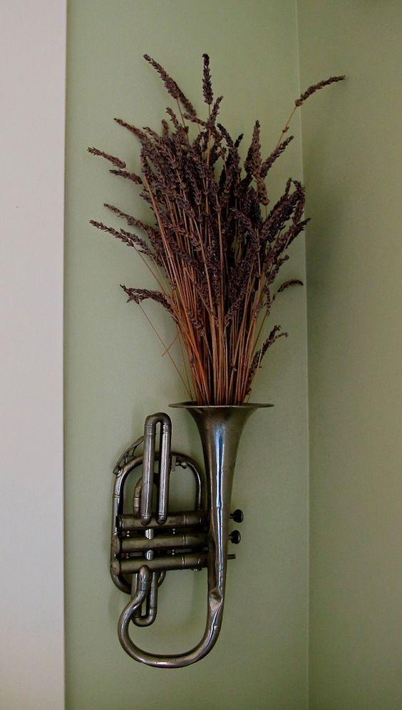 wall mounted vintage cornet filled with aromatic lavender