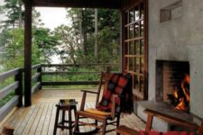 08 cabin porch with a rough concrete fireplace
